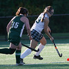 Manchester: Manchester Essex's Patty Wright dribbles around Pentucket's Corinne Colpitts during the Hornets' 3-1 win yesterday. Photo by Kate Glass/Gloucester Daily Times Monday, October 5, 2009