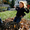 Gloucester: Cate Delaney, 7, of Annisquam jumps in a small pile of leaves that she and her brother, Jack, 4, raked up yesterday afternoon. The two raked the whole yard by themselves, but had a difficult time finding enough leaves because most of them are still on the trees. Photo by Kate Glass/Gloucester Daily Times Monday, October 12, 2009