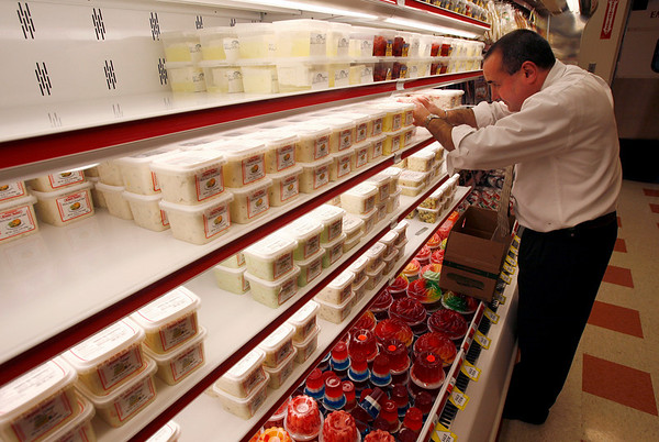 Gloucester: Todd Brown, Deli Supervisor, arranges products on the shelves in Market Basket at Gloucester Crossing. The store will be opening at 7am tomorrow. Photo by Kate Glass/Gloucester Daily Times Monday, October 5, 2009