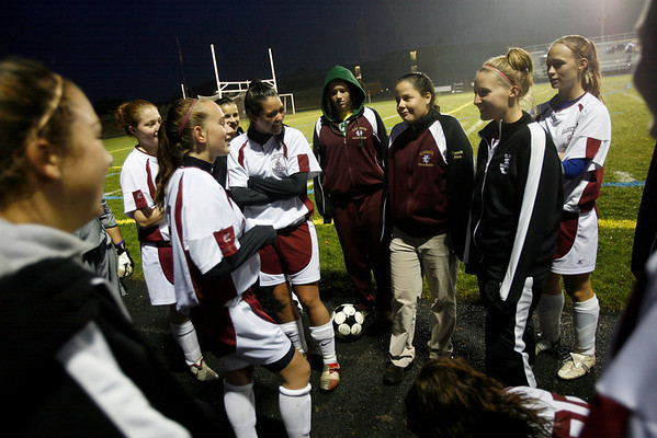 Gloucester: Gloucester girls soccer coach Alex White gathers the team together before their game against Swampscott. White was named Northeastern Conference South Coach of the Year for turning around a winless program. Photo by Kate Glass/Gloucester Daily Times Tuesday, October 27, 2009
