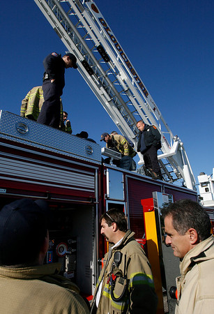 Gloucester: Members of the Gloucester Fire Department check out the features of their new ladder truck during training at Stage Fort Park yesterday. Training will continue for the other shifts throughout the week. Photo by Kate Glass/Gloucester Daily Times Monday, October 19, 2009
