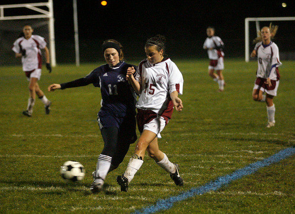Gloucester: Gloucester's Stephanie Kelley knocks the ball away from Swampscott's Merry Ball during their game at Newell Stadium last night. Photo by Kate Glass/Gloucester Daily Times Tuesday, October 27, 2009