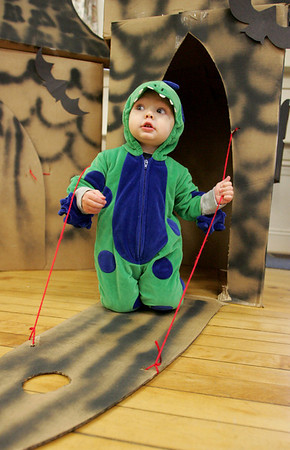 Rockport: Anderson DeLuca, 15 months, plays in cardboard boxes made to look like castles at the Halloween party at Sandy Bay Preschool Friday morning. After the party kids went on a parade around town to trick-or-treat at local buisnesses. Mary Muckehoupt/Gloucester Daily Times
