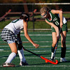Manchester: Pentucket's Charlotte Pope knocks the ball away from Manchester Essex's Kyle Marsh at Coach Ed Field Field in Manchester yesterday. Photo by Kate Glass/Gloucester Daily Times Monday, October 5, 2009