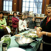 Manchester: Cookbook author Nora Chang speaks about how she tries to cook without having a lot to clean afterwards during her cooking demonstration at the Manchester Public Library Saturday morning. Chang made some simple Chinese stir-fry recipes that even young adults can make for their families. Mary Muckenhoupt/Gloucester Daily Times