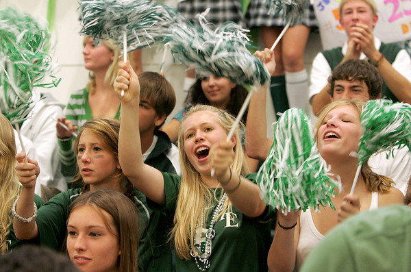 Manchester: Caitlin Parker cheers with her friends during the fall sports pep rally at Manchester Essex High School Friday afternoon. This was the first pep rally held in the school's new gymnasium. Mary Muckenhoupt/Gloucester Daily Times