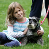 Rockport: Emily McKeon, 4, hugs Chloe, a schnauzer belonging to Jackie Hutchings during the annual Blessing of thr Animals at Millbrook Meadow Sunday afternoon.  Emily brought a unicorn stuffed animal to be blessed but really took a liking to her new canine freind. Mary Muckenhoupt/Gloucester Daily Times