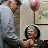 "Gloucester: Bertram Wolfson of Gloucester wishes Edna New a happy 110th birthday during her party at the Seacoast Nursing and Rehab Center yesterday. Wolfson used to play piano and remembers Edna dancing and singing along. ""She still keeps perfect time,"" he says.  Photo by Kate Glass/Gloucester Daily Times Tuesday, October 13, 2009"