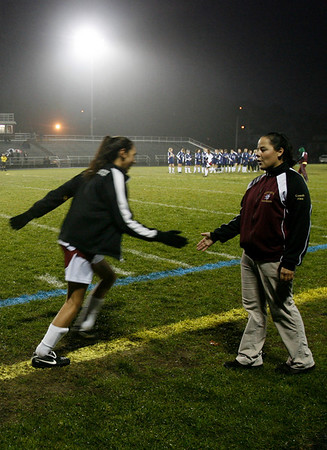 Gloucester: Gloucester girls soccer coach Alex White slaps hands with the girls on her team as they are introduced before their game against Swampscott. White was named Northeastern Conference South Coach of the Year for turning around a winless program. Photo by Kate Glass/Gloucester Daily Times Tuesday, October 27, 2009