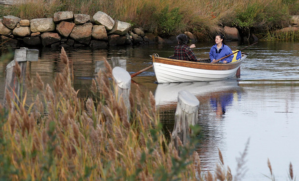 Essex: David and Marykay Eschrich of Ipswich row along the Essex River yesterday afternoon. Although most of the foliage was still green, they said it was a beautiful day for rowing. Photo by Kate Glass/Gloucester Daily Times