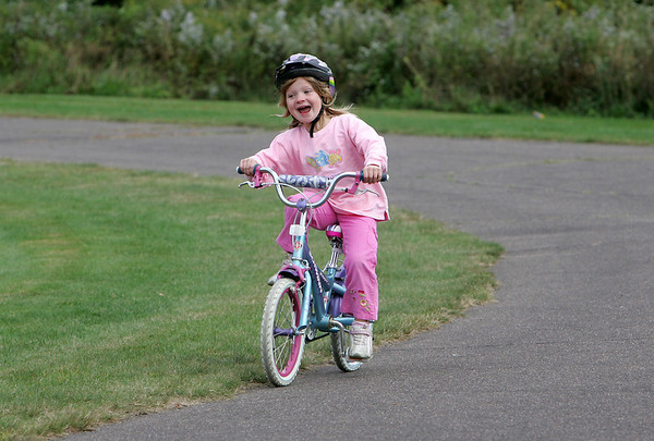Rockport: Acadia Grenier, 5, happily rides her bike around the track behind Rockport High School Thursday afternoon.  After a few spins around the playground acadia and her brother Camden, 7, and their friends headed off to the Amelia Grace Place playground to play. Mary Muckenhoupt/Gloucester Daily Times