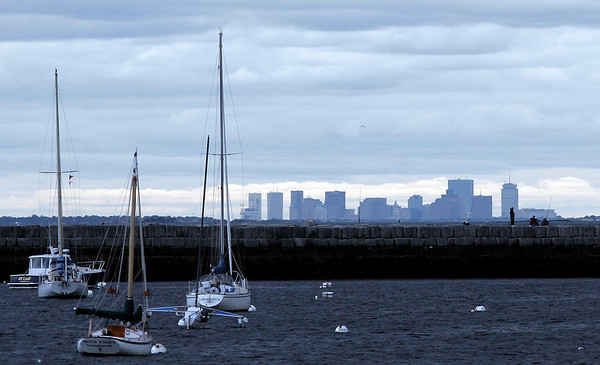 Gloucester: A group of people fish off the Dog Bar breakwater with a clear view of the Boston skyline behind them. Photo by Kate Glass/Gloucester Daily Times Wednesday, September 30, 2009
