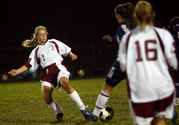 Gloucester: Gloucester's Elle Wierbicky tries to steal the ball during their game against Swampscott at Newell Stadium last night. Photo by Kate Glass/Gloucester Daily Times Tuesday, October 27, 2009