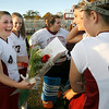 Gloucester: Brianna Alosio laughs while reading a card signed by her Gloucester field hockey teammates during their last home game against Marblehead yesterday afternoon. Alosio, Meg Keegan and Emily Interrante were honored during a halftime ceremony as the only seniors on the team. Photo by Kate Glass/Gloucester Daily Times Monday, October 26, 2009