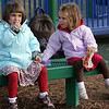 Rockport: Laura Penaloza, 4, left, and Grace Englis, 3, share a snack together while taking a break from playing at the Amelia Grace Place playground Friday afternoon. Mary Muckenhoupt/Gloucester Daily Times