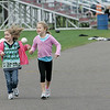 Rockport: Jane Reilly, 6, left and Hailey Faulds, 6, watch a girls soccer practice as they run over to the playground from a field hockey game behind Rockport High School Thursday afternoon. Mary Muckenhoupt/Gloucester Daily Times
