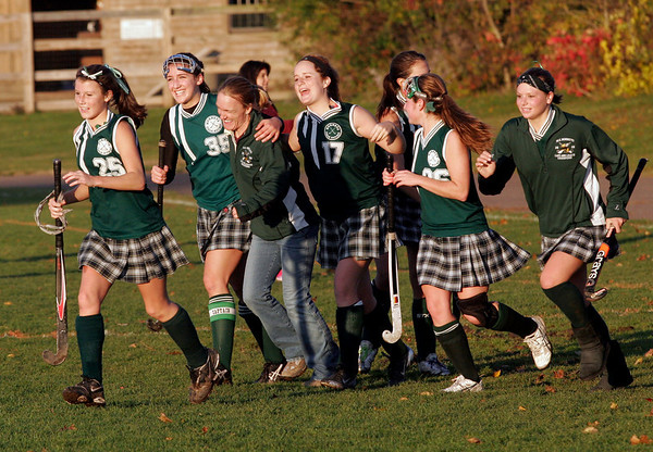 Rockport: Members of the Manchester Essex field hockey team celebrate as their coach, Pam Grant, earns her 100th career win and the team finishes the season undefeated win their 6-1 win over Rockport yesterday afternoon. From left are: Amelia Burke, Amelia Cohen, Pam Grant, Molly Friedman, Hannah Beardsley and Lizzy Ball. Photo by Kate Glass/Gloucester Daily Times Thursday, October 29, 2009