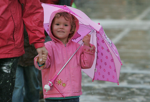 Rockport: Natalie Lamond, 4, stays dry with her pink raincoat and umbrella as she walks with her mother to pick up her up her brothers at Rockport Elementary School Wednesday afternoon. Mary Muckenhoupt/Gloucester Daily Times