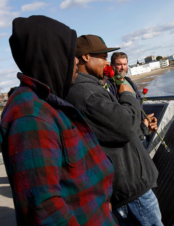 Gloucester: Milton Ortiz kisses a rose before tossing it into the ocean to honor his brother, Jaime Ortiz, who fell overboard the lobster boat Dominatrix on Tuesday. Photo by Kate Glass/Gloucester Daily Times Wednesday, October 14, 2009