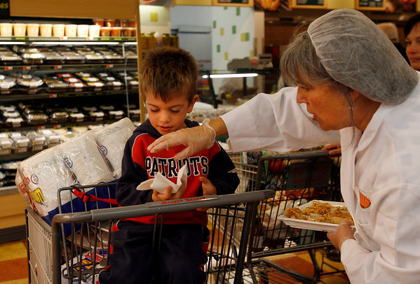 Gloucester: Patrice Kamb hands Nicholas White, 4, of Gloucester a sample of pizza at Market Basket yesterday afternoon. Photo by Kate Glass/Gloucester Daily Times Wednesday, October 7, 2009