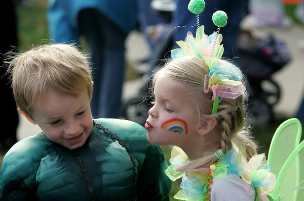 Rockport: Ella Lovenz puckers up to give her friend Jeremy Adamson a kiss on the check as the Sandybay Preschool goes trick-or-treating in downtown Rockport Friday. Mary Muckenhoupt/Gloucester Daily Times