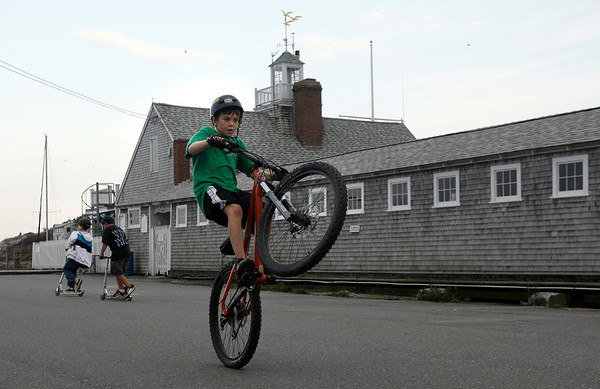 Rockport: Dylan Vecchione of Rockport pops a wheelie on his bike while hanging out at T Wharf with his friends Wednesday afternoon. Photo by Kate Glass/Gloucester Daily Times