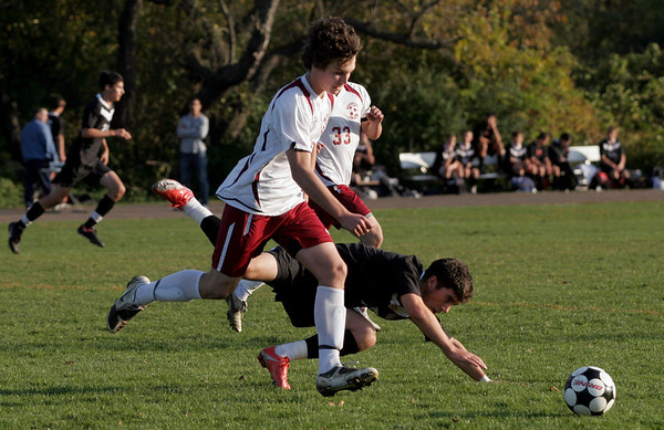 Rockport: Rockport's Cam Tibert dribbles around North Andover's Gareth Dudney as he trips during the Vikings' 1-0 loss to the Knights. Photo by Kate Glass/Gloucester Daily Times Tuesday, October 20, 2009