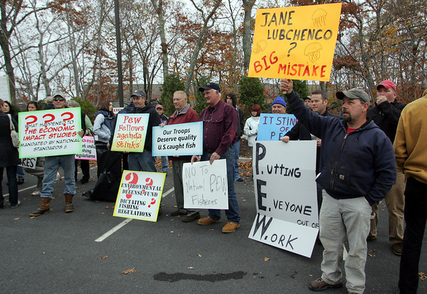 Gloucester: Fishermen hold signs at the NOAA building at Blackburn Industrial Park to protest against NOAA and NMFS regulations and enforcement tactics Friday morning. Mary Muckenhoupt/Gloucester Daily Times
