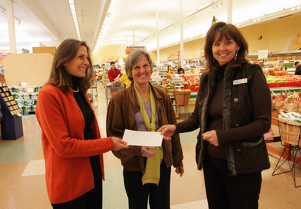 Gloucester: Kathy Clancy, left, chair of fundraising for the Gloucester Education Foundation, and Maggie Rosa, center, executive director for the Gloucester Education Foundation, receive a check from Stop and Shop Store Manager Margaret Pelser for $1340 which was all the proceeds from Stop and Shop's Cusomer Appreciation Days held the las weekend in September. Mary Muckenhoupt/Gloucester Daily Times