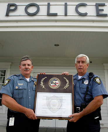 Rockport: Rockport Police Chief Tom McCarthy and Officer Roger Lesch show the station's Certificate of Authentication, which they were recently awarded. Photo by Kate Glass/Gloucester Daily Times Monday, October 5, 2009