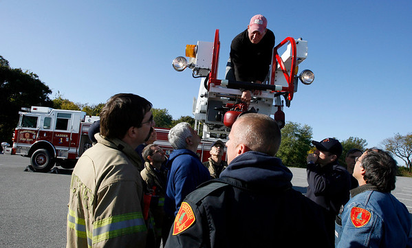Gloucester: Steve Melchior of Pierce Manufacturing demonstrates different features of the Gloucester Fire Department's new ladder truck during training at Stage Fort Park yesterday. Training will continue for the other shifts throughout the week. Photo by Kate Glass/Gloucester Daily Times Monday, October 19, 2009