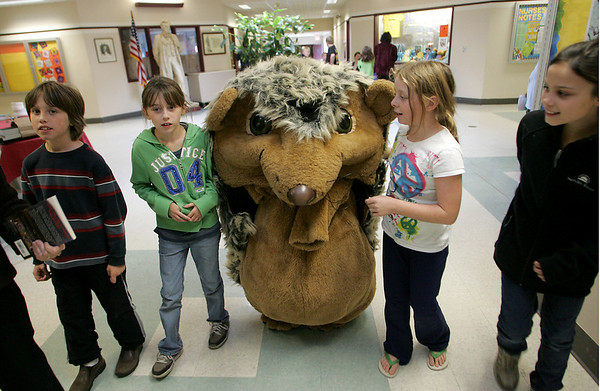 """Rockport: From left, fifth graders Jack Rukeyser, Thora Taylor, Anna Cloherty and Lucy Williams walk with Emma Rukeyser who was dressed like the hedgehog from the book """"Hedgie Blasts Off"""" a book by Jan Brett at the annual book fair at Rockport Elementary School Wednesday afternoon. Mary Muckenhoupt/Gloucester Daily Times"""