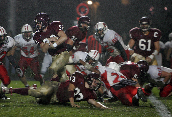 Gloucester: Gloucester running back Conor Ressel carries the ball during the first half of the Gloucester vs. Salem football game at Newell Stadium Friday night.  Mary Muckenhoupt/Gloucester Daily Times