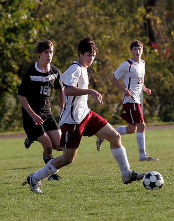 Rockport: Rockport's Kevin Corrigan runs ahead of North Andover's Sherwin Yamin as Andrew Burnham looks on. Photo by Kate Glass/Gloucester Daily Times Tuesday, October 20, 2009
