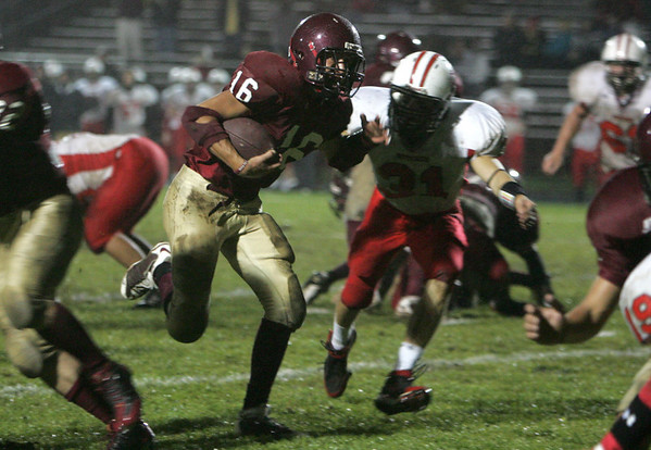 Gloucester: Gloucester's Gil Brown runs for the end zone past Salem's Josh Gillooly during the football game at Newell Stadium Friday night. Mary Muckenhoupt/Gloucester Daily Times
