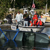Essex: A car driven by an elderly woman was pulled out of the river at Essex town landing after the car drove into the water Saturday afternoon. Both passengers evacuated the car while it was in the water and were taken to a hospital. The Beverly dive team was called in to help retrieve the car which was fully submerged. Mary Muckenhoupt/Gloucester Daily Times