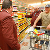 "Gloucester: Dick Tarr, center, and Roger Serbagi, right, talk with Ray Castles, Market Basket's Store Director, as they shop during the store's opening day yesterday. Serbagi says ""I love that this is here. They have better produce, cheaper prices and friendlier people...I'm going to live here."" Photo by Kate Glass/Gloucester Daily Times Wednesday, October 7, 2009"