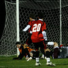 Gloucester: Salem keeper Danny McCarthy collides with Gloucester midfielder Ben Hannah to make a save at Newell Stadium last night. Photo by Kate Glass/Gloucester Daily Times Tuesday, October 13, 2009