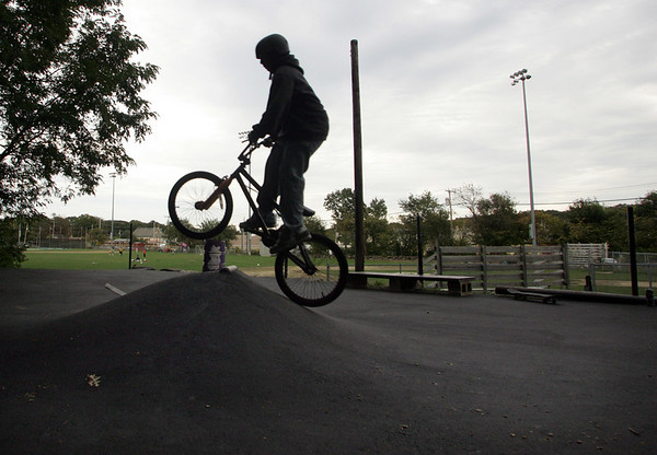 Rockport: Anthony King, 11, of Rockport rides his bike up a newly paved ramp at the Matt Waddell Skate Park behind the YMCA Ben Beyae Teen Center Friday evening. The skate park is undegoing steps to improve the safety of the area, as part of a wider effort by police and teen center officials to crack down on illegal activity happening in nearby woods. Mary Muckenhoupt/Gloucester Daily Times