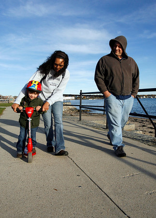 Gloucester: Zachary Tuohy, 3, of Gloucester gets a push from Alicia and Alex Tuohy as he rides his scooter down the Boulevard on Monday afternoon. Photo by Kate Glass/Gloucester Daily Times Monday, October 26, 2009