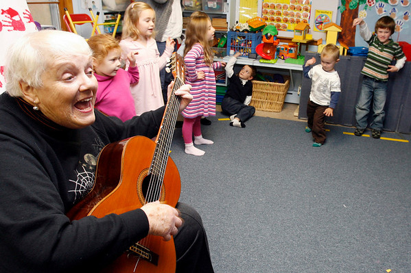 """Manchester: Carol Mead and the children at Shore Nursery School perform """"I'm a Little Teapot"""" for members of the Manchester Council on Aging yesterday afternoon during a Halloween Sing-Along. Photo by Kate Glass/Gloucester Daily Times Wednesday, October 28, 2009"""