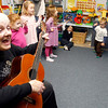 "Manchester: Carol Mead and the children at Shore Nursery School perform ""I'm a Little Teapot"" for members of the Manchester Council on Aging yesterday afternoon during a Halloween Sing-Along. Photo by Kate Glass/Gloucester Daily Times Wednesday, October 28, 2009"