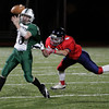 Lynn: Manchester Essex's Alex Carr gets taken down by Lynn Tech's Joe Bradey during the football game at Manning Field Saturday night. Mary Muckenhoupt/Gloucester Daily Times