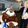 Gloucester: Kim Spaner adds three teddy bears to the pile collected by the Rotary Club for the Department of Children & Families during a luncheon at the Gloucester Elks Lodge yesterday afternoon. Photo by Kate Glass/Gloucester Daily Times Tuesday October 20, 2009
