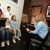 Gloucester: Christine Wyse talks to a group of kids during the casting for an upcoming Gorton's commercial at Blackburn Performing Arts Center Saturday morning. An open castng call was held for all residents of Cape Ann to come in and talk about why they love Gloucester. Auditioning here is, back row, Ronnie Cinelli, 11, left, and Anthony Guardino, 12. Front row, from left, Maria Cinelli, 9, Carolyn Cinelli, 8, and Anna Cinelli, 3, all from Gloucester. Mary Muckenhoupt/Gloucester Daily Times