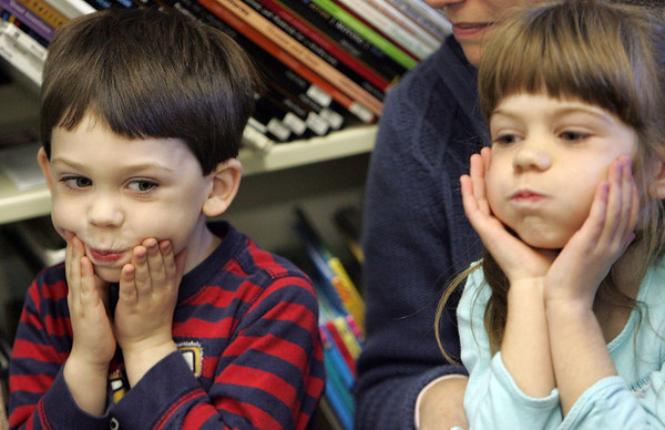 Essex: Kevin Adams, 4, and his sister Heather, 6, make big puffy cheeks like the pumpkin in a Halloween story that was read by librarian April Wanner during story time at the TOHP Burnham library Thursday afternoon. Mary Muckenhoupt/Gloucester Daily Times