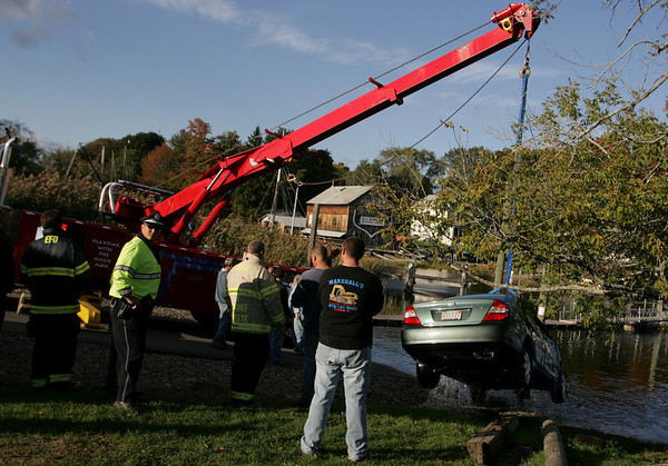 Essex: A car driven by an elderly woman was pulled out of the river at Essex town landing after the car drove into the water Saturday afternoon. Both passengers evacuated the car while it was in the water and were taken to a hospital. Mary Muckenhoupt/Gloucester Daily Times