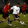 Gloucester: Gloucester's Paulo Lopes tries to get the ball past Salem's Jake Theriault at Newell Stadium last night. Photo by Kate Glass/Gloucester Daily Times Tuesday, October 13, 2009