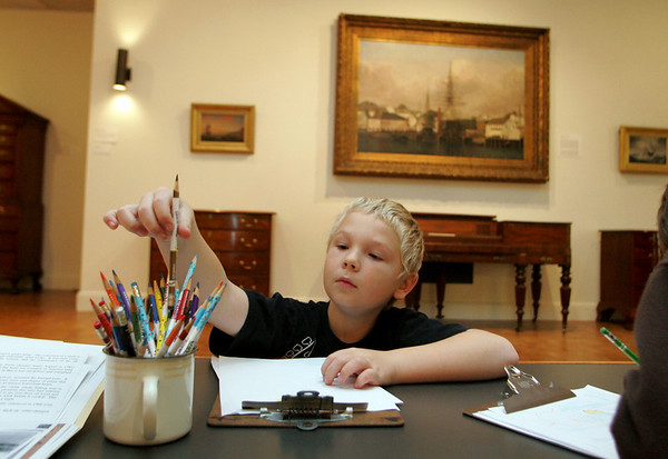Gloucester: Hunter Scott, 8, of Gloucester works on his drawing of a lighthouse in the Fitz Henry Lane room of the Cape Ann Museum Thursday morning.  The Meet me at the Museum program lead by Courtney Richardson focused on learning about the islands off of Cape Ann so home schooled students were brought up to the Fitz Henry Lane room to look at his paintings and draw their versions of Thatcher Island or Ten Pound Island. Mary Muckenhoupt/Gloucester Daily Times
