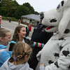 Manchester: (clockwise from left) Molly Moore, Aoife Dalton, and Lydia Shaw, all second graders at Manchester Memorial Elementary School, hug Sparky yesterday morning as members of the Manchester Fire Department visit the school for Fire Awareness Week. Photo by Kate Glass/Gloucester Daily Times